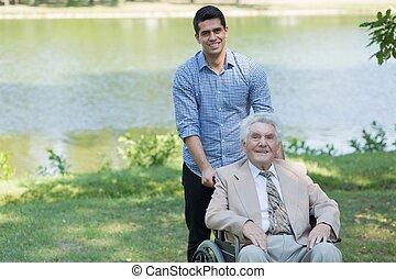 Disabled senior man and grandson