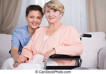 Disabled senior woman and carer