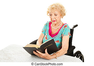 Disabled Senior Woman Reads Bible