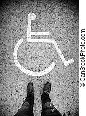 Disabled sign on the asphalt
