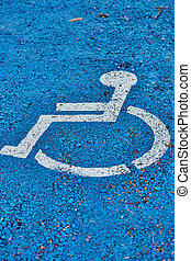 disabled sign painted on asphalt