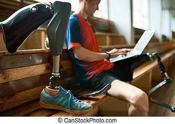 Disabled Sportsman Using Laptop