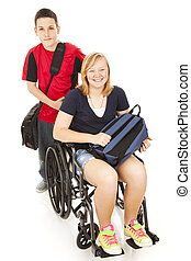Teen boy pushes his disabled friend in her wheelchair on the way to school.
