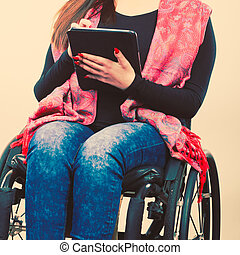 Disabled student with tablet ebook.