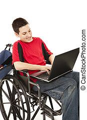 Disabled Teen Using Computer - Disabled teen boy using a...