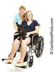 Disabled Teen with Mom - Disabled teen girl in wheelchair,...