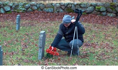 Disabled veteran in graveyard. - Disabled veteran with...