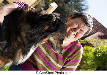 disabled woman and an half breed dog - disabled woman...