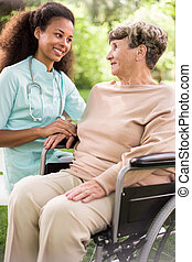Disabled woman and caring doctor