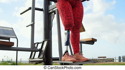 Disabled woman exercising in the park 4k - Disabled woman ...