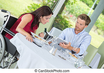 disabled woman having lunch with husband in a restaurant