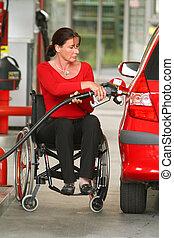 A woman is Gehbenidert. Wheelchairs.