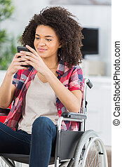 disabled woman in a wheelchair on the phone