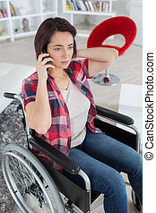 disabled woman in wheelchair on mobile phone