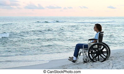 Disabled Woman Lonely - Lonely disabled woman sits and...