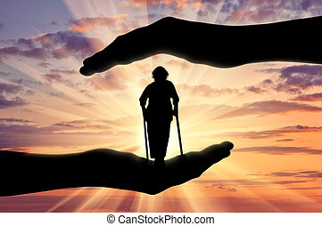 Disabled woman on crutches in hands sunset