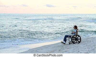 Disabled Woman Solitude - Frail disabled woman sits in...