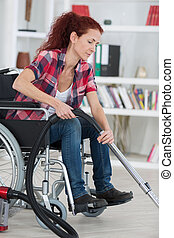 disabled woman using a vacuum cleaner