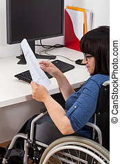 Disabled woman with documents