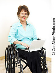 Disabled Woman with Netbook - Disabled woman in wheelchair,...