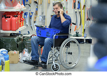 disabled worker buying tools in a store