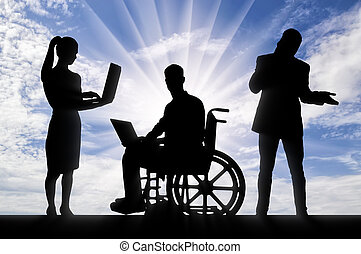 Disabled worker in a wheelchair with a laptop and his work team