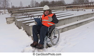Disabled worker on wheelchair talking
