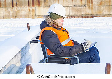 Disabled worker on wheelchair writing