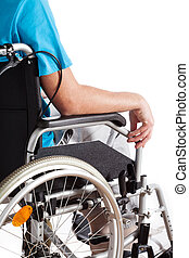 Disabled's life, man sitting on a wheelchair