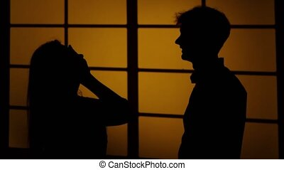 Disagreement between two people. Relationships. Silhouette. Close up