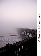 Disappearing in Mist - A pier disappearing into the fog at ...