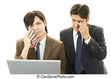 Disappointed Asian businessmen crying