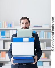 Disappointed businessman carrying boxes