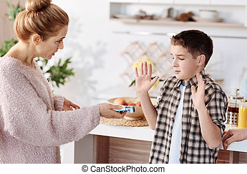 Disappointed caring mother warning her son
