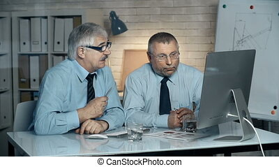 Disappointed Client - Close up of two businessmen seated at...