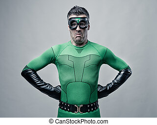 Disappointed funny superhero grimacing and looking at...