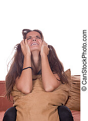 Disappointed girl crying with pillow