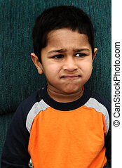 disappointed - An handsome Indian kid looking very...