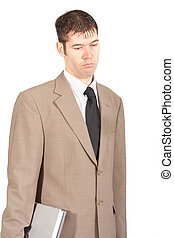 Disappointed Worker with Laptop - A professionally dressed...