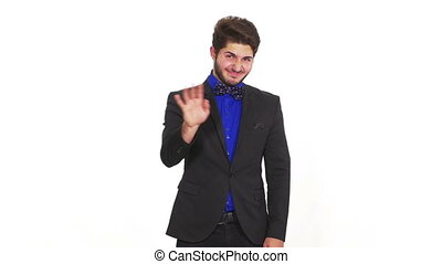 Disapproving young man in elegant suit