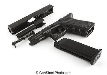 Disassembled firearm - A handgun that has been broken down...