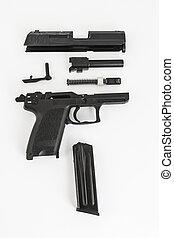 disassembled gun, pistol, on white background