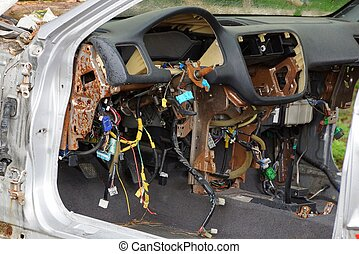 disassembled panel of an old car with a lot of wires