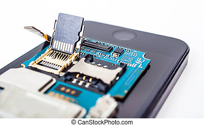 disassembled smartphone isolated on white background...