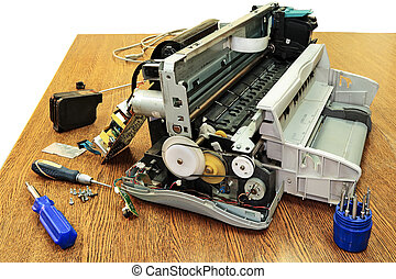 Disassembled the printer. - The printer is disassembled,...