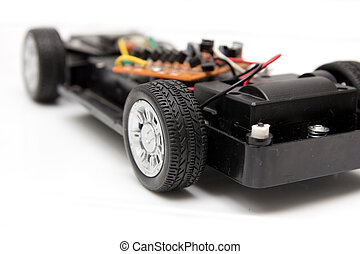 disassembled toy car on a white background