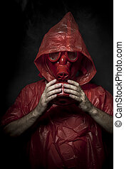 Disaster, A man in a gas mask over  the smoke. black background and red colors