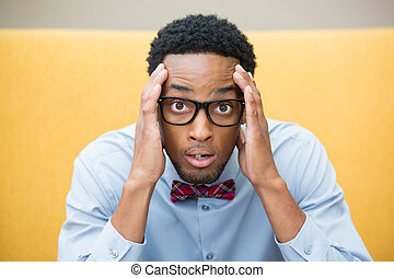 Disbelief - Closeup portrait, stunned nerd young man, hands...