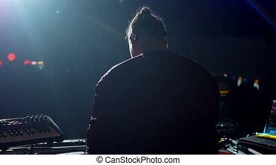 Disc camera dancing crowd - Slow motion of disc jockey...