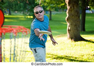 disc golf - man playing frisbee golf